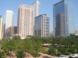 The sleek Houston skyline forms the dramatic backdrop for Discovery Green.